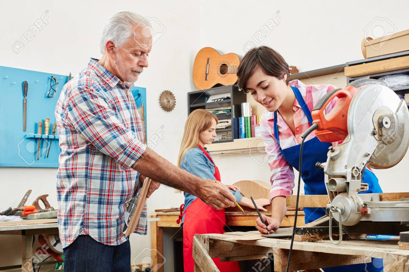 Master Craftsman In Woodworking Test For Apprentice Stock Photo