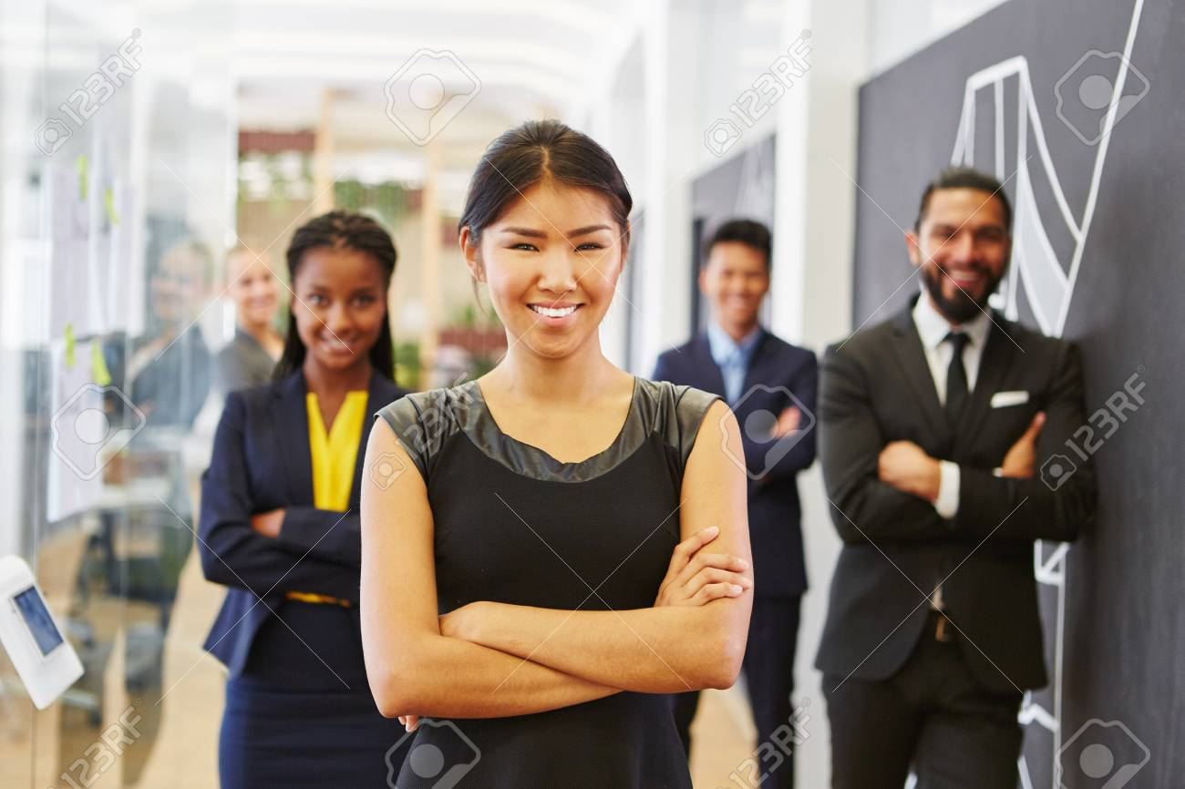 Young asian woman as start-up CEO with her team - 108161629