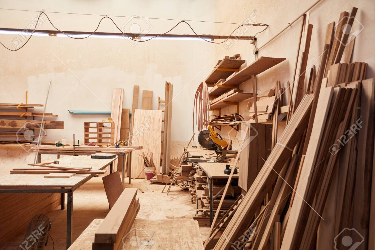 Empty workshop in a joinery with wood warehouse and workbench - 118216333