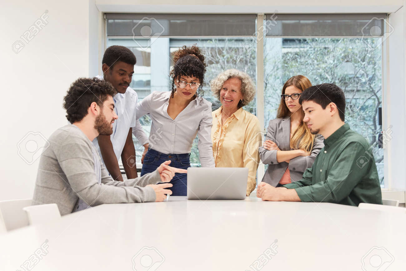 Start-Up Business Team At Laptop Computer At Meeting In Conference Room - 121134722