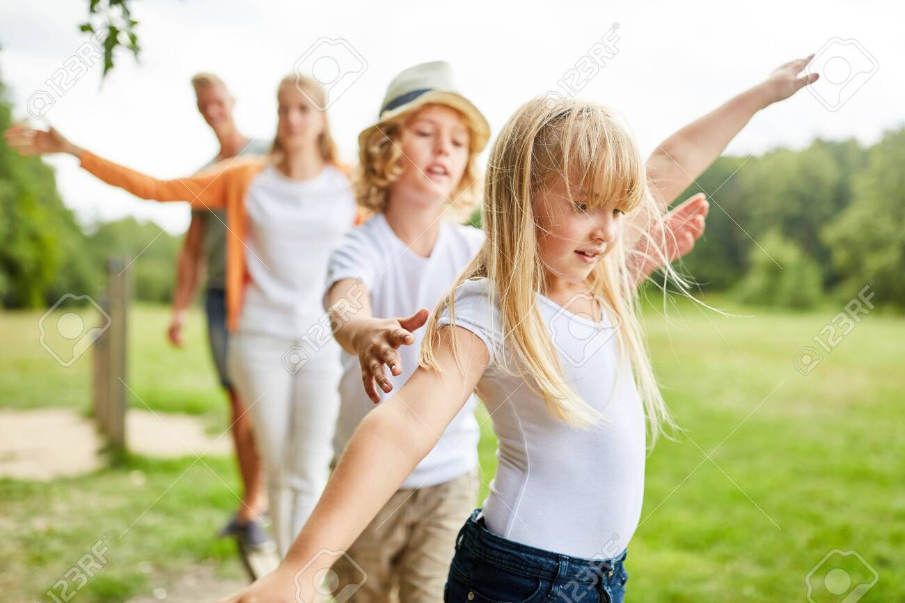 Family and kids exercise fitness and balance on trim path - 121986829