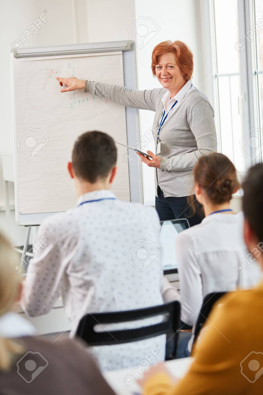 Businesswoman as lecturer makes a business presentation with flipchart - 127076665