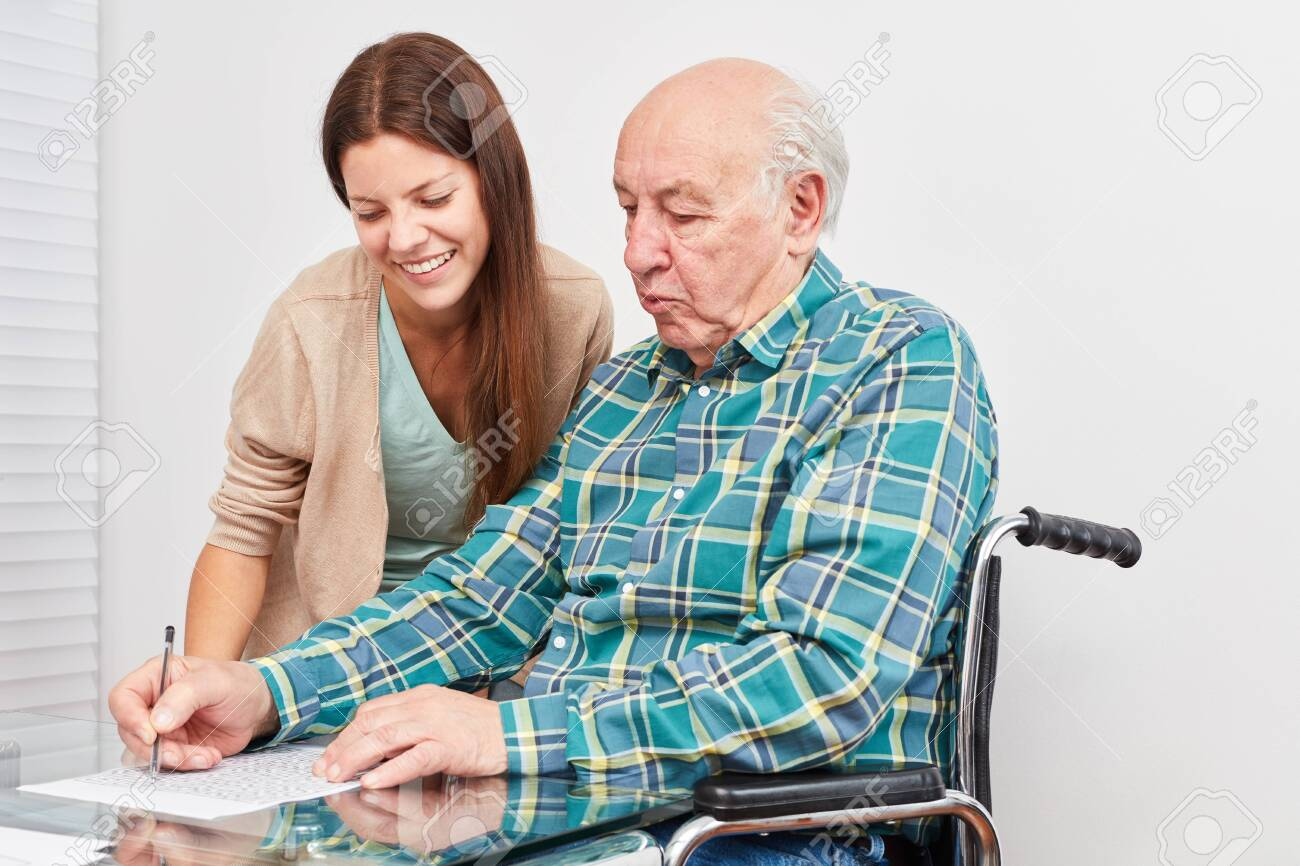 Old man solves puzzles and trains his memory as a prevention against dementia - 126577515