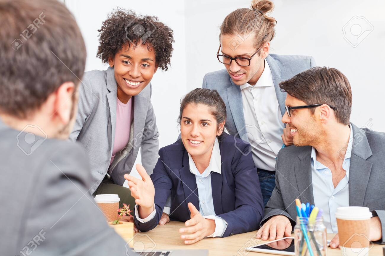 Business woman with colleagues in a negotiation about a cooperation - 133717553