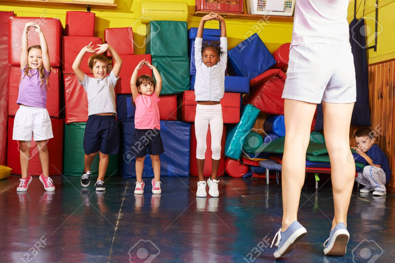 Happy group of kids together while kid sports in preschool - 137171168