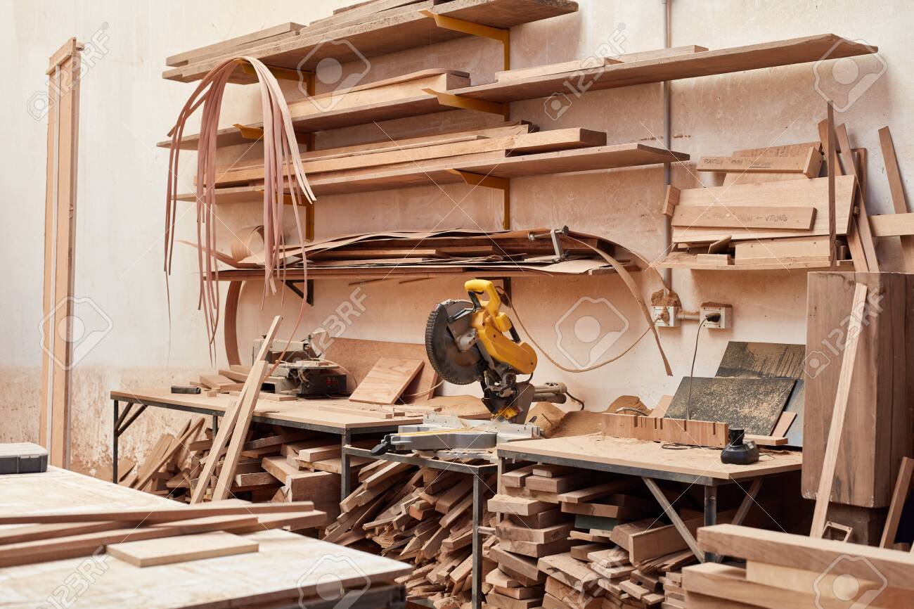 Empty workshop with stock of wood and a chop saw in a carpentry operation - 144314230