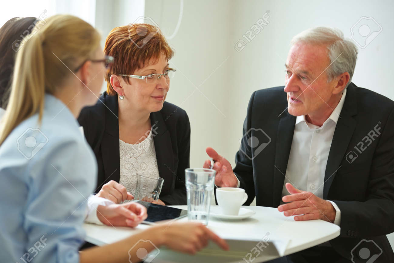 Business team planning at table using tablet pc - 153201975