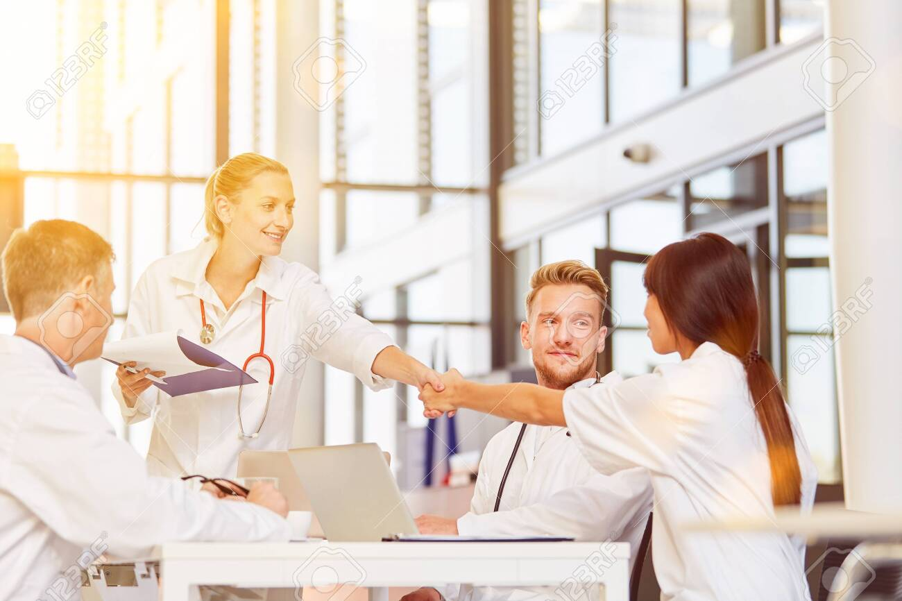 Doctors give handshake to greeting at meeting in a hospital - 153117540