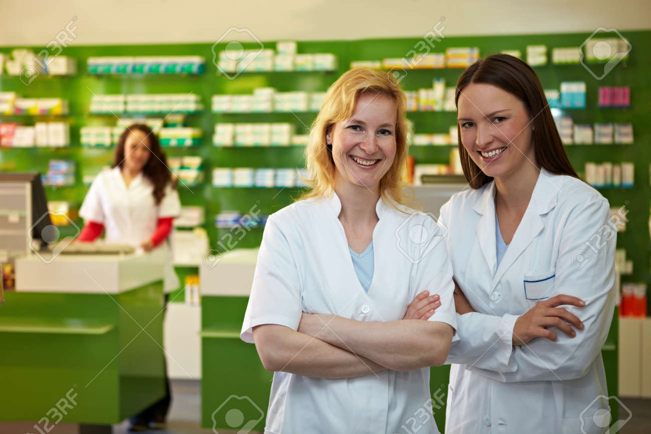 Two laughing pharmacists are happy in a pharmacy - 158481118