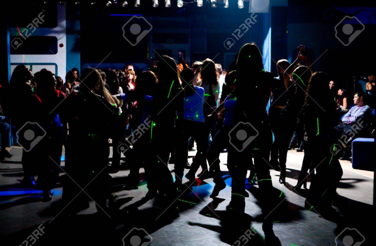 Dancing people in an underground club - 12717454