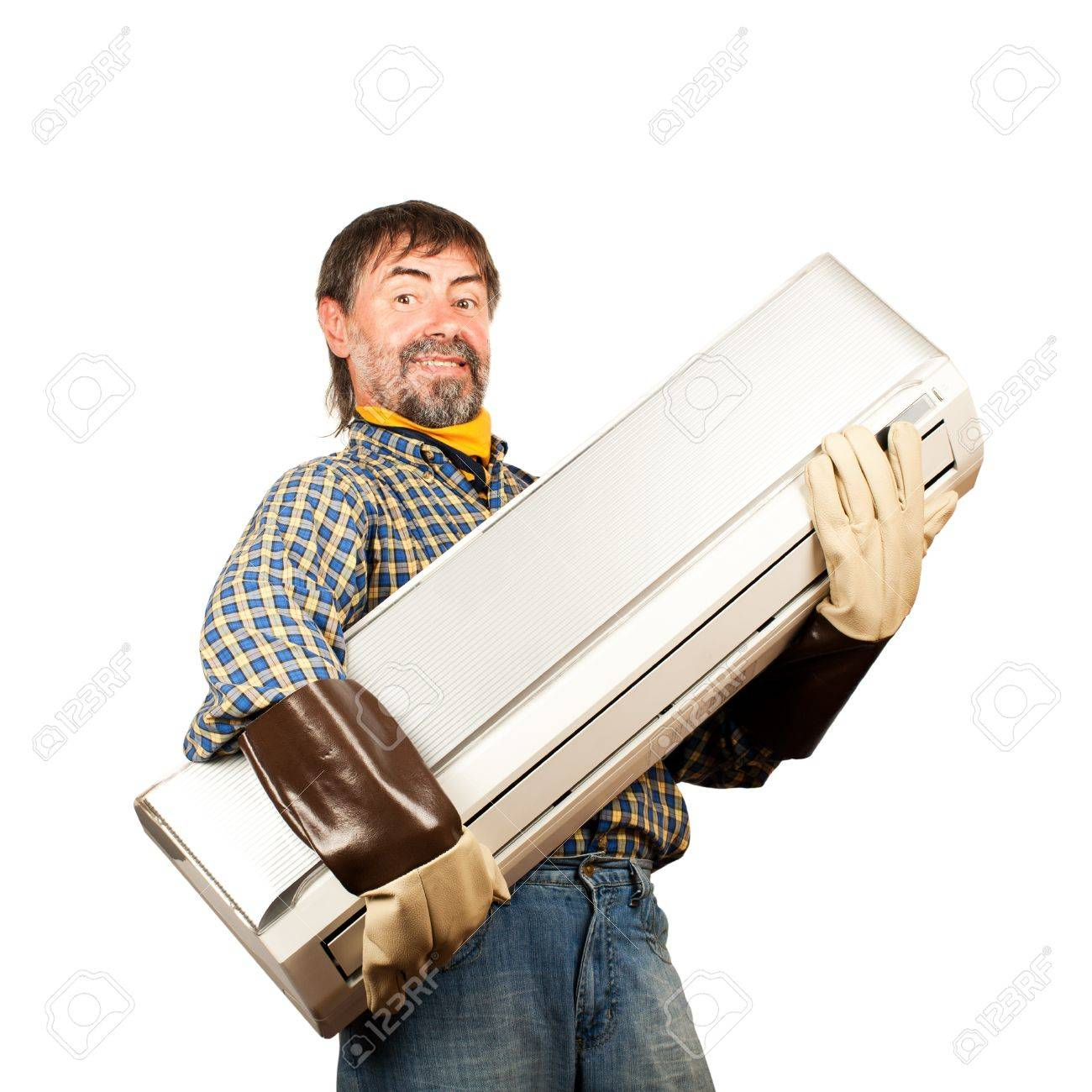 Air conditioning master holding in his arms new air conditioner and smiling Isolated on a white - 14748581