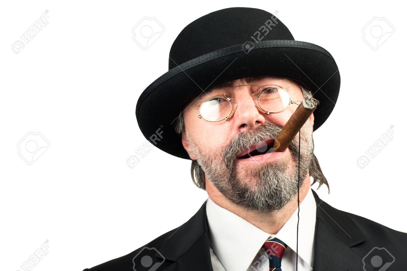 Closeup portrait of stilish man in a hat and in glasses smoking cigar and looking at you Stock Photo - 19822030