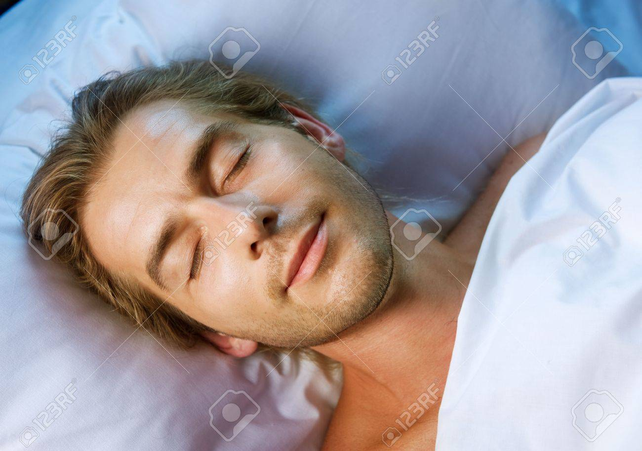 Handsome Man Sleeping in his Bed Stock Photo - 7683390
