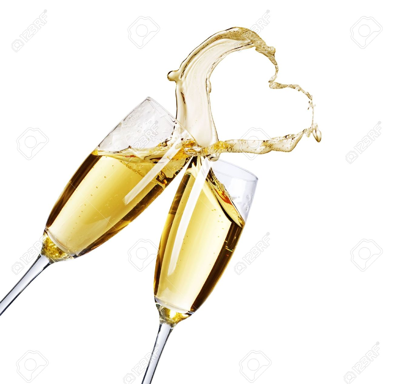 champagne flutes two champagne glasses with abstract heart splash stock photo