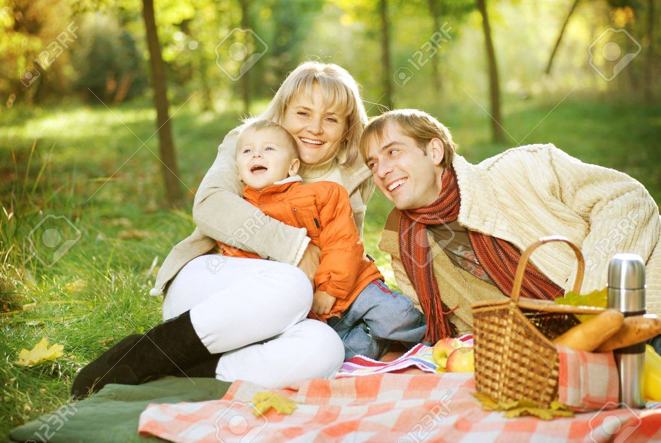 Picnic in Autumn Park. Happy Family outdoor Stock Photo - 9353248