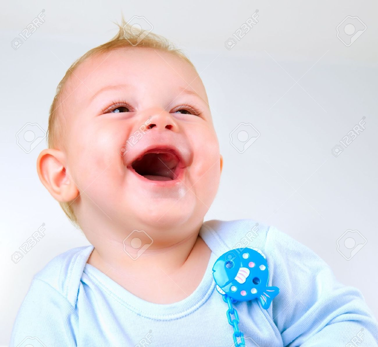cute baby boy laughing stock photo, picture and royalty free image