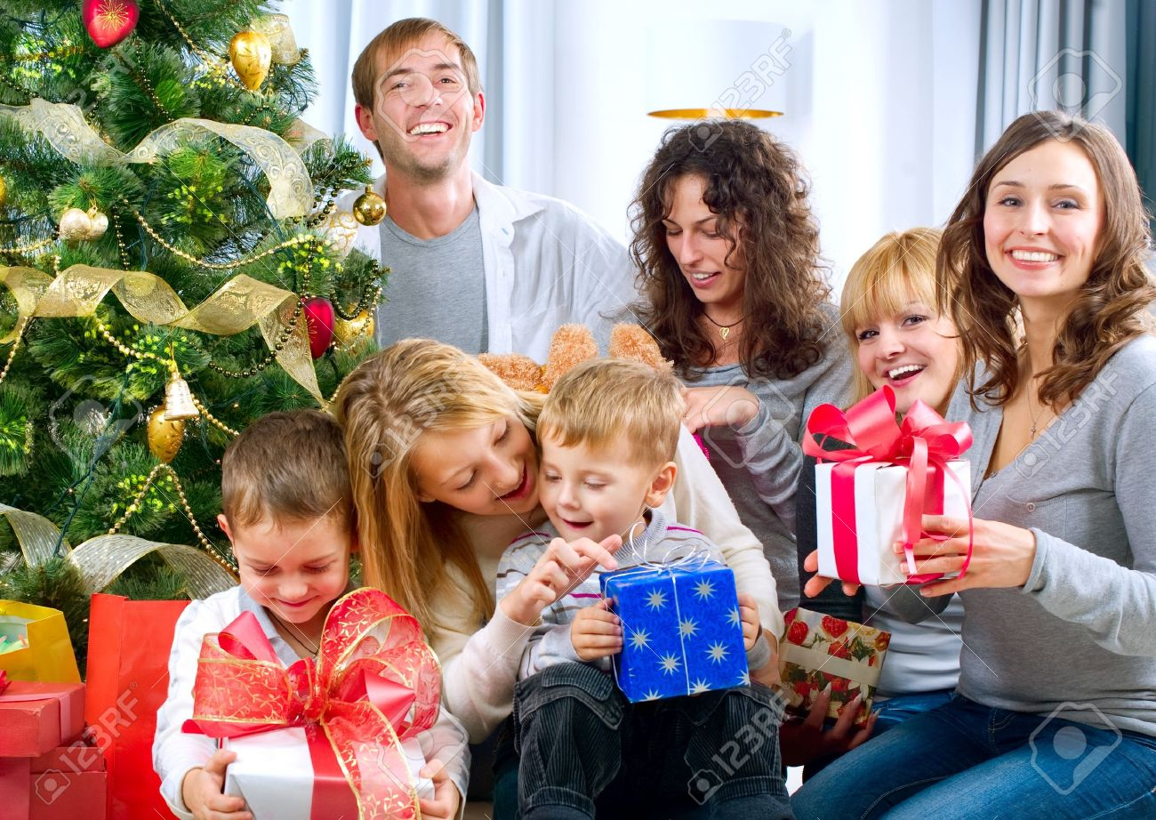 Family Christmas Gifts.Happy Big Family Holding Christmas Presents At Home