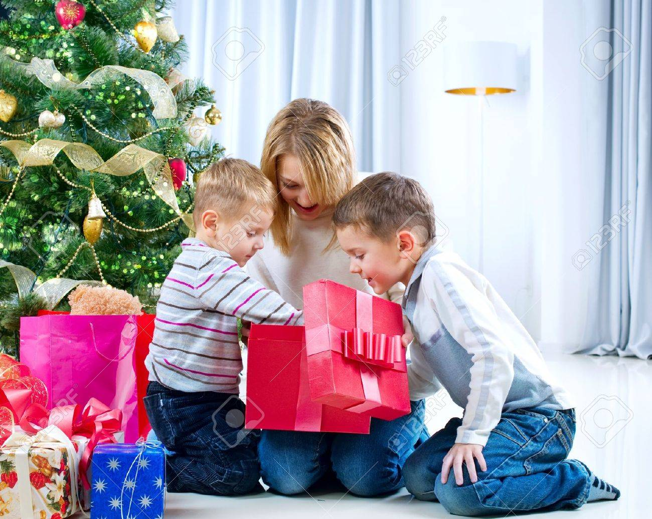 Children With Christmas Gifts. Christmas Tree Stock Photo, Picture ...