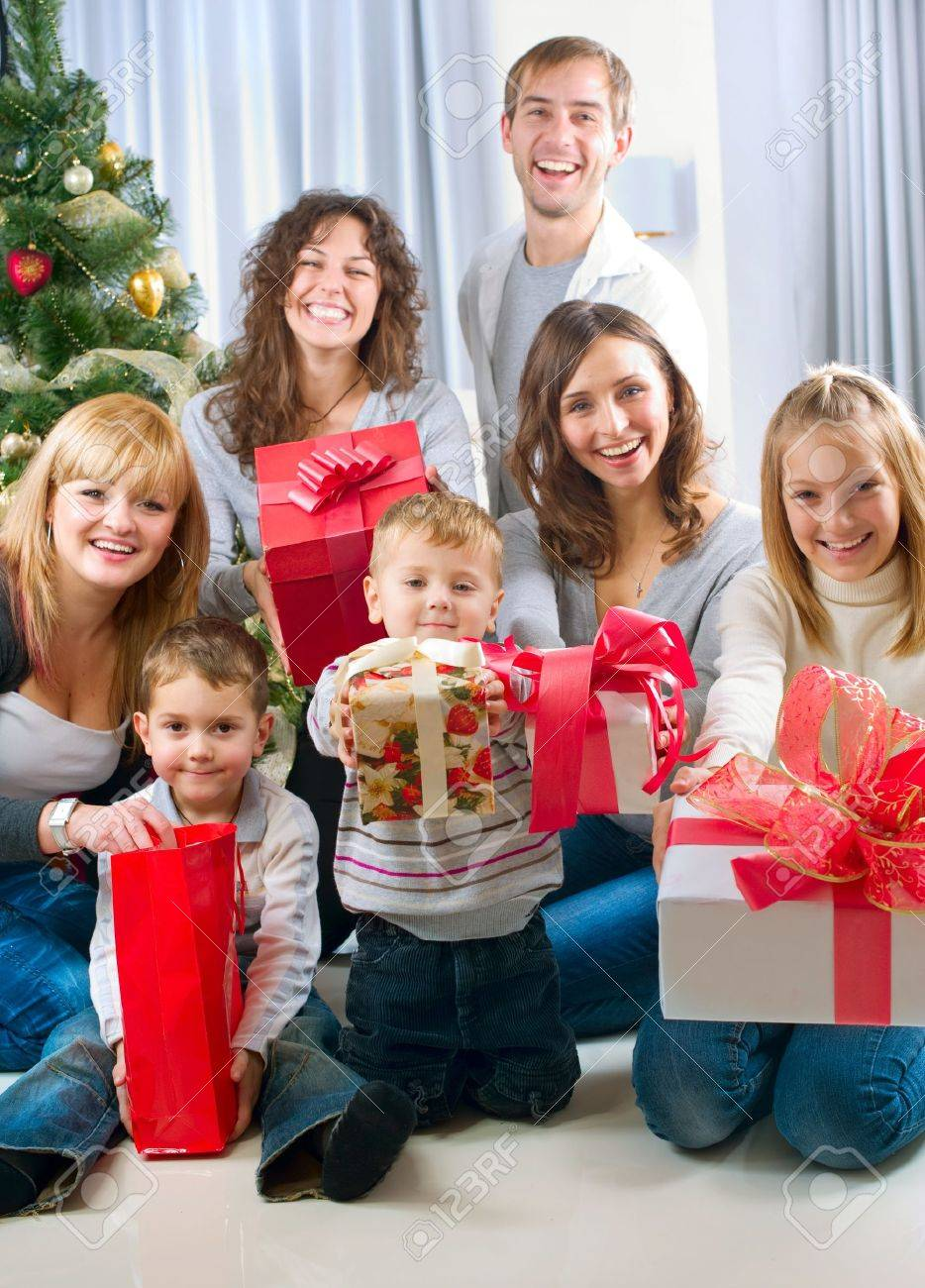 Happy Big family holding Christmas presents at home Stock Photo - 11329972