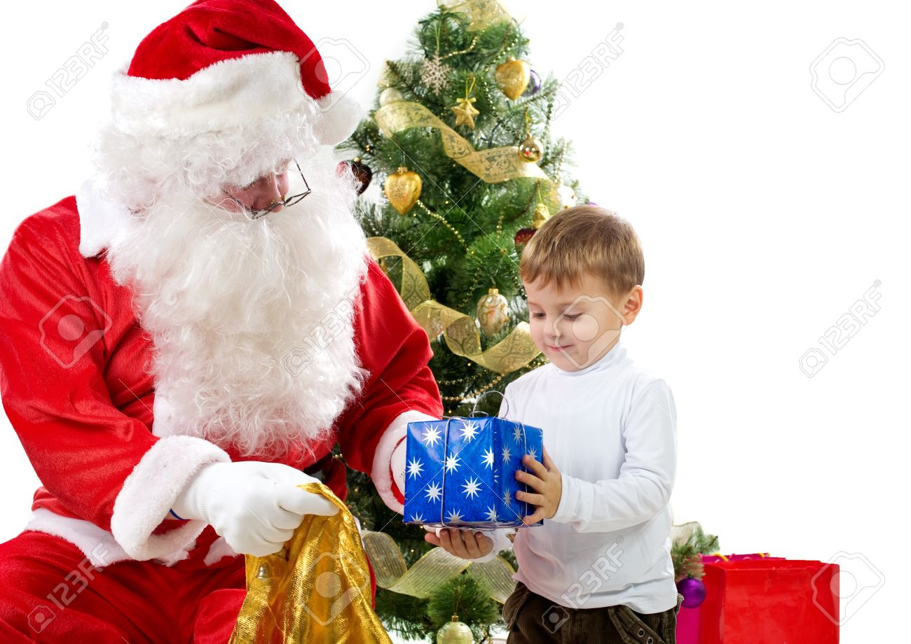 Santa Claus Giving Christmas Gifts To Children Stock Photo, Picture ...