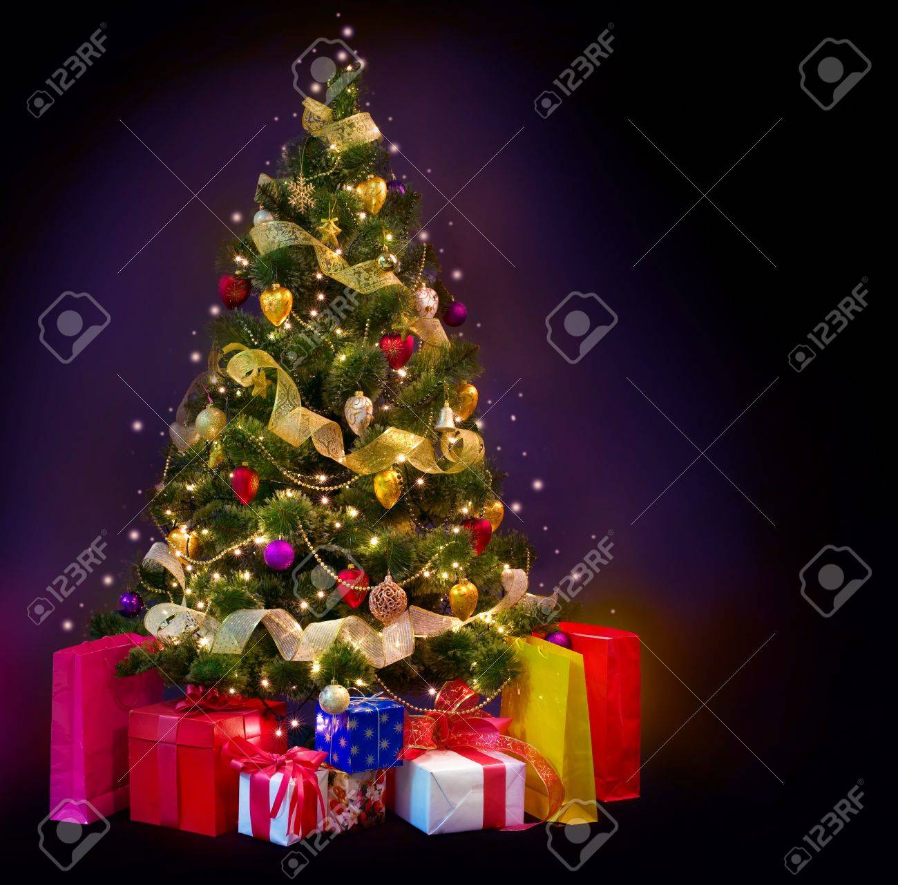 Christmas Tree with Gifts isolated on black Stock Photo - 11559880