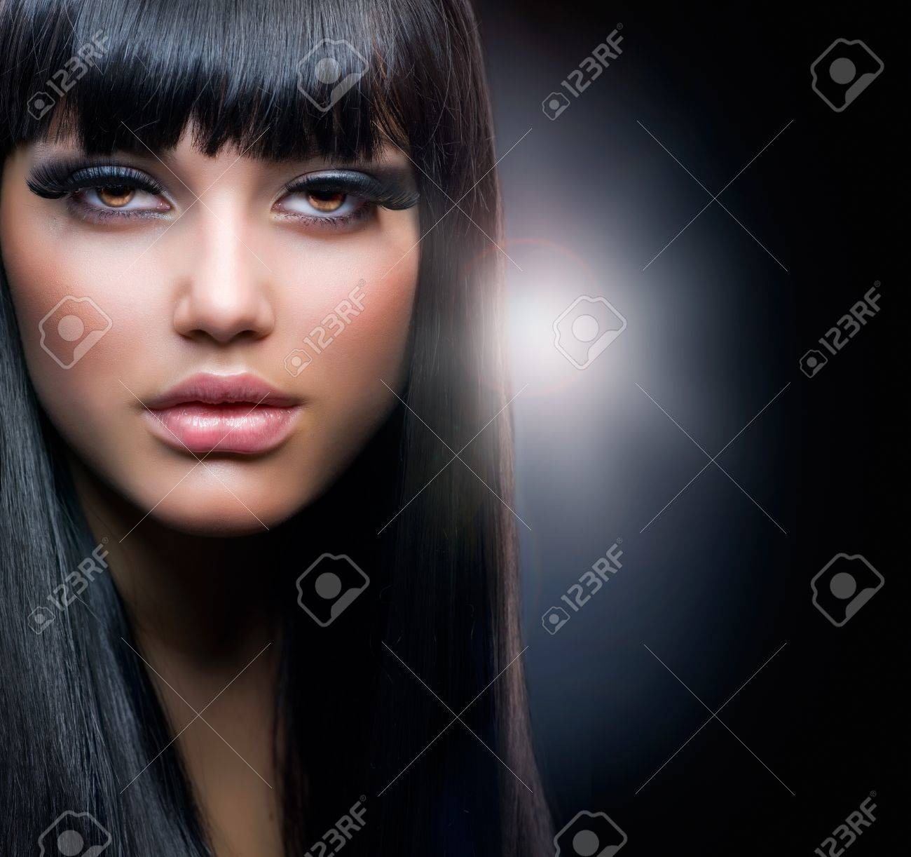 Fashion Brunette. Beautiful Makeup and Healthy Black Hair Stock Photo - 12382038