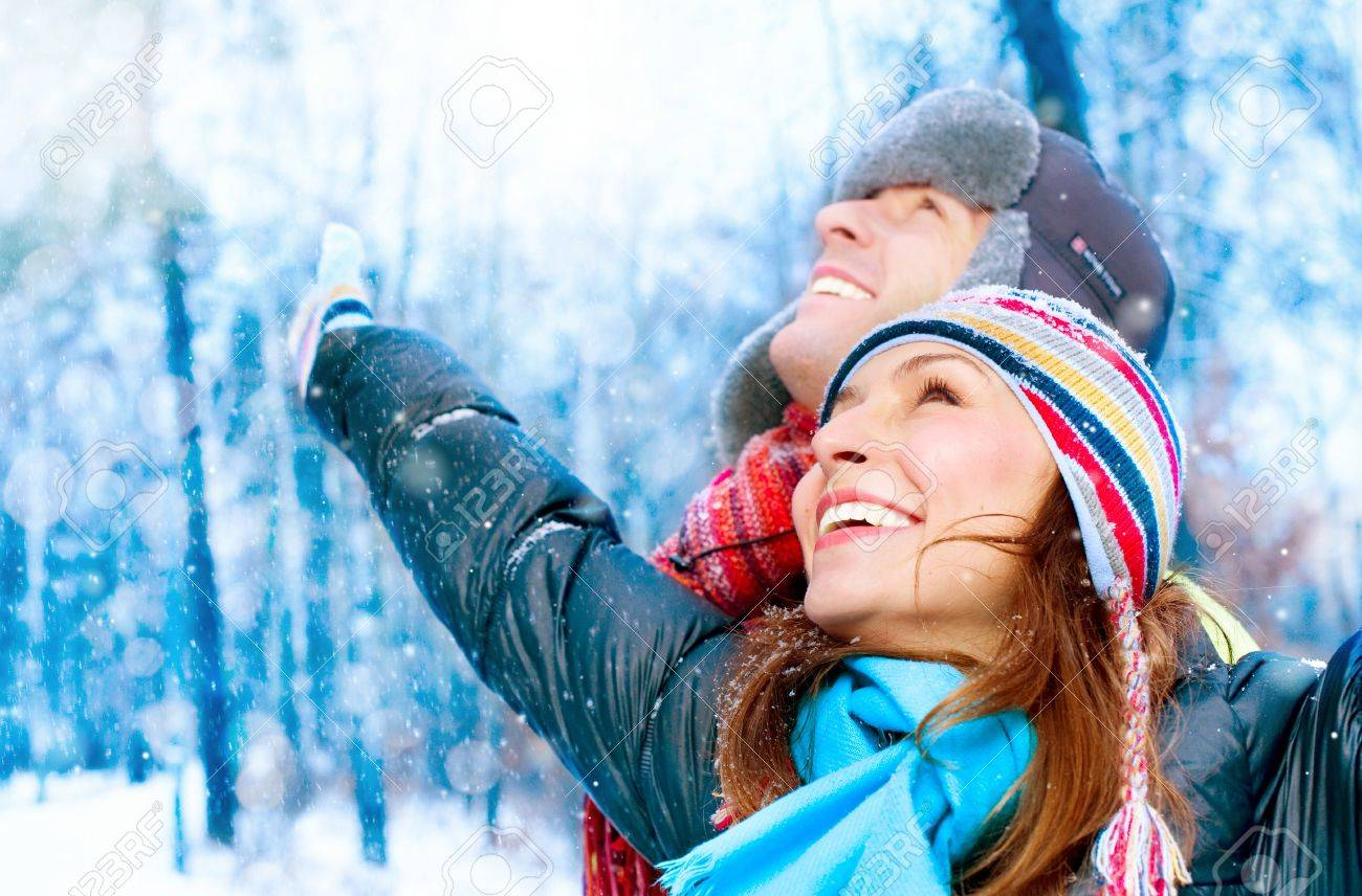 Happy Young Couple In Winter Park Having Fun. Family Outdoors Stock Photo - 12382036
