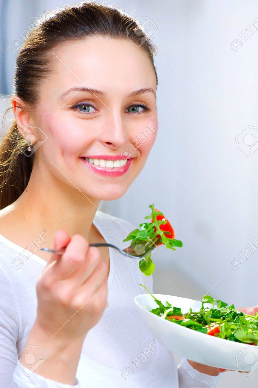 Diet. Healthy Young Woman Eating Vegetable Salad Stock Photo - 12382099
