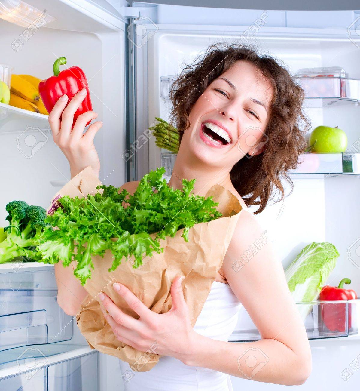 Beautiful Young Woman near the Refrigerator with healthy food Stock Photo - 13064625