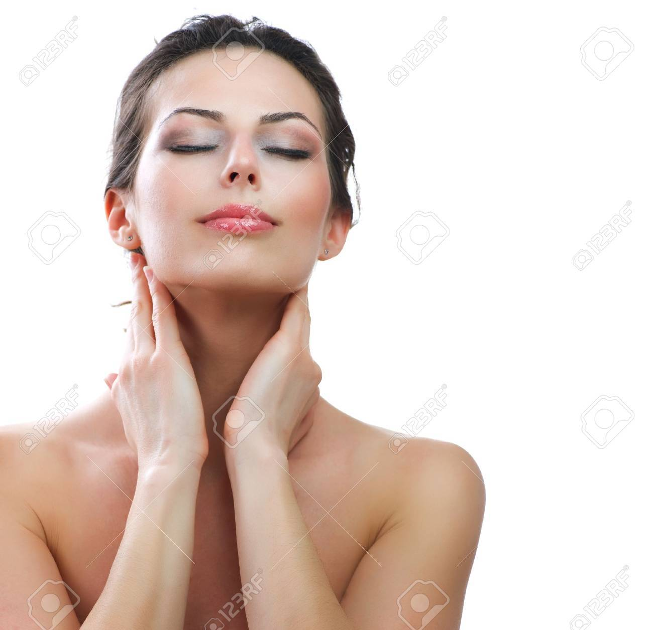 Beautiful Young Woman touching her Face  Skincare  Perfect Skin Stock Photo - 13064631