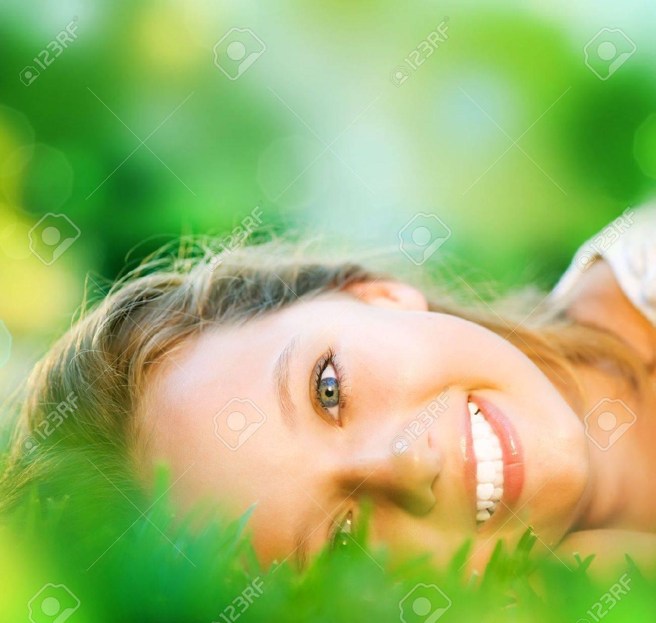 Spring Girl in Green Grass - 13549917