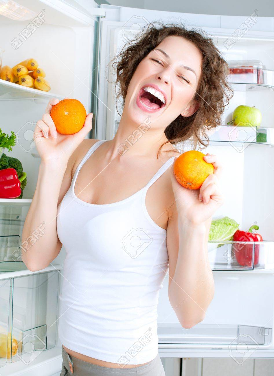 Beautiful Young Woman near the Refrigerator with healthy food Stock Photo - 14054142