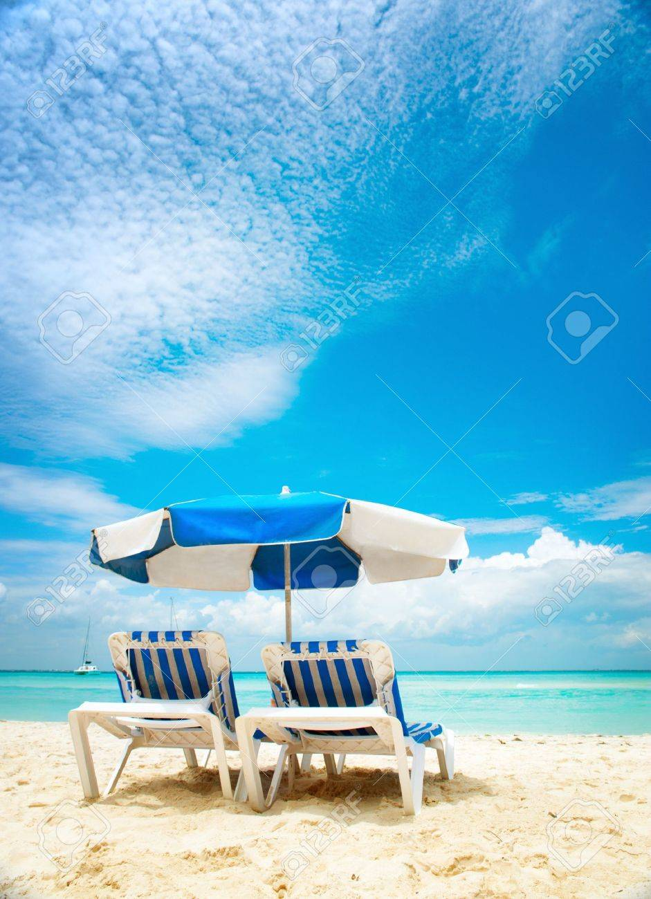 Vacation and Tourism concept  Sunbeds on the beach Stock Photo - 14193541