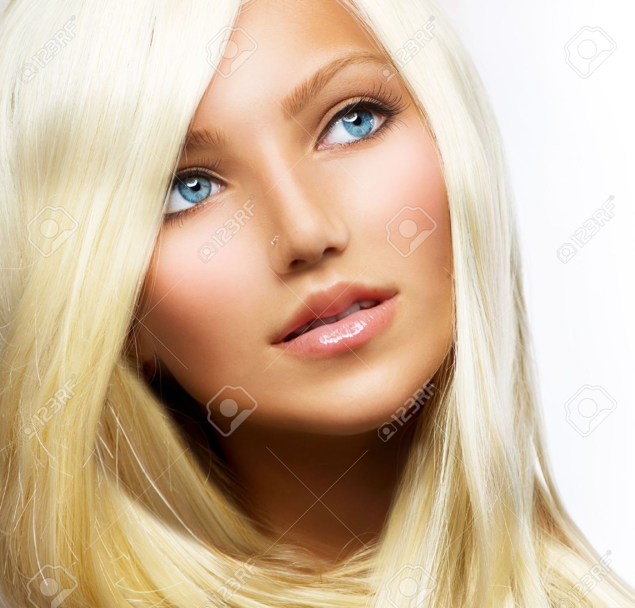 Beautiful Blond Girl isolated on a White Background Stock Photo - 14778946
