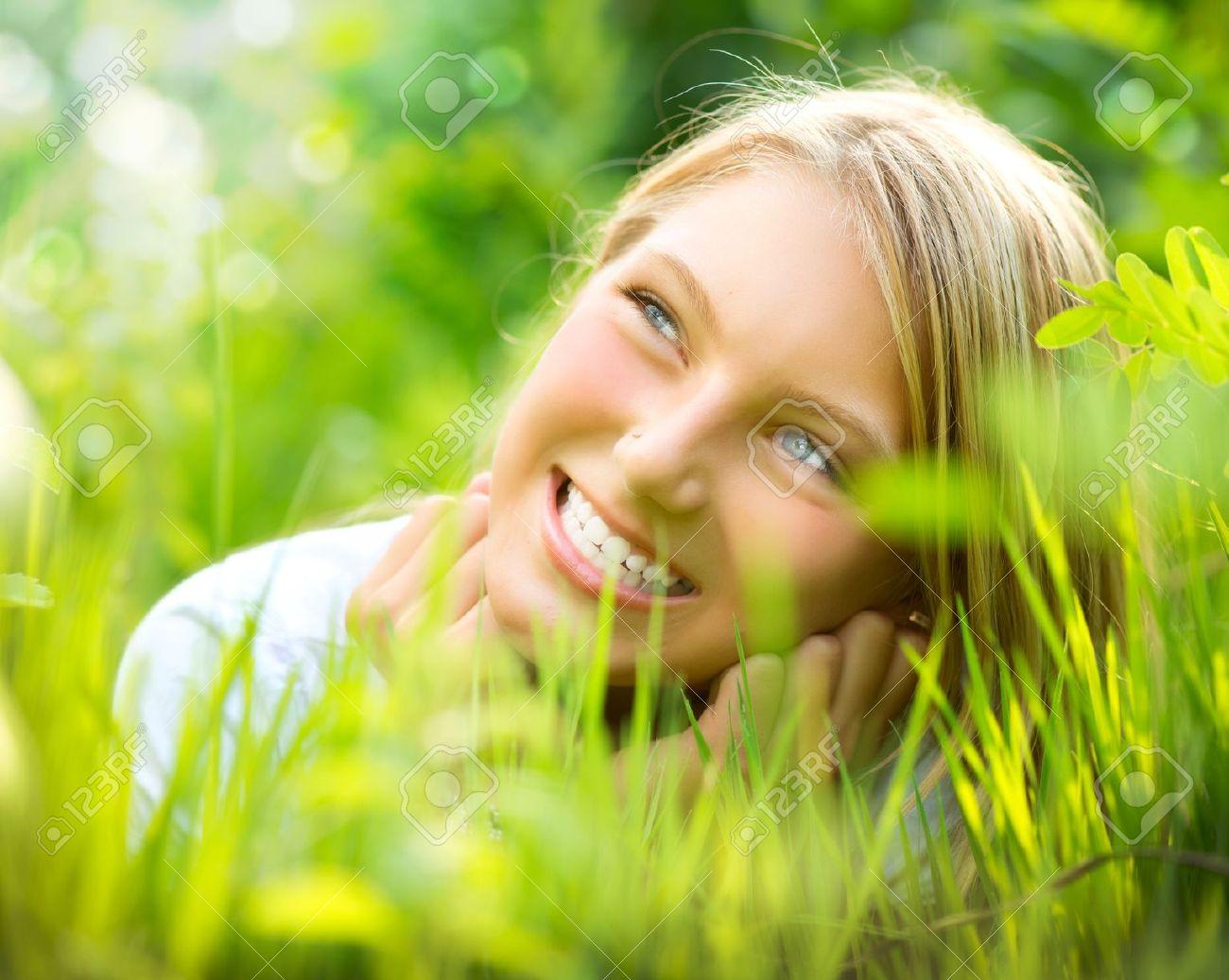 Beautiful Smiling Girl in Green Grass Stock Photo - 14719029