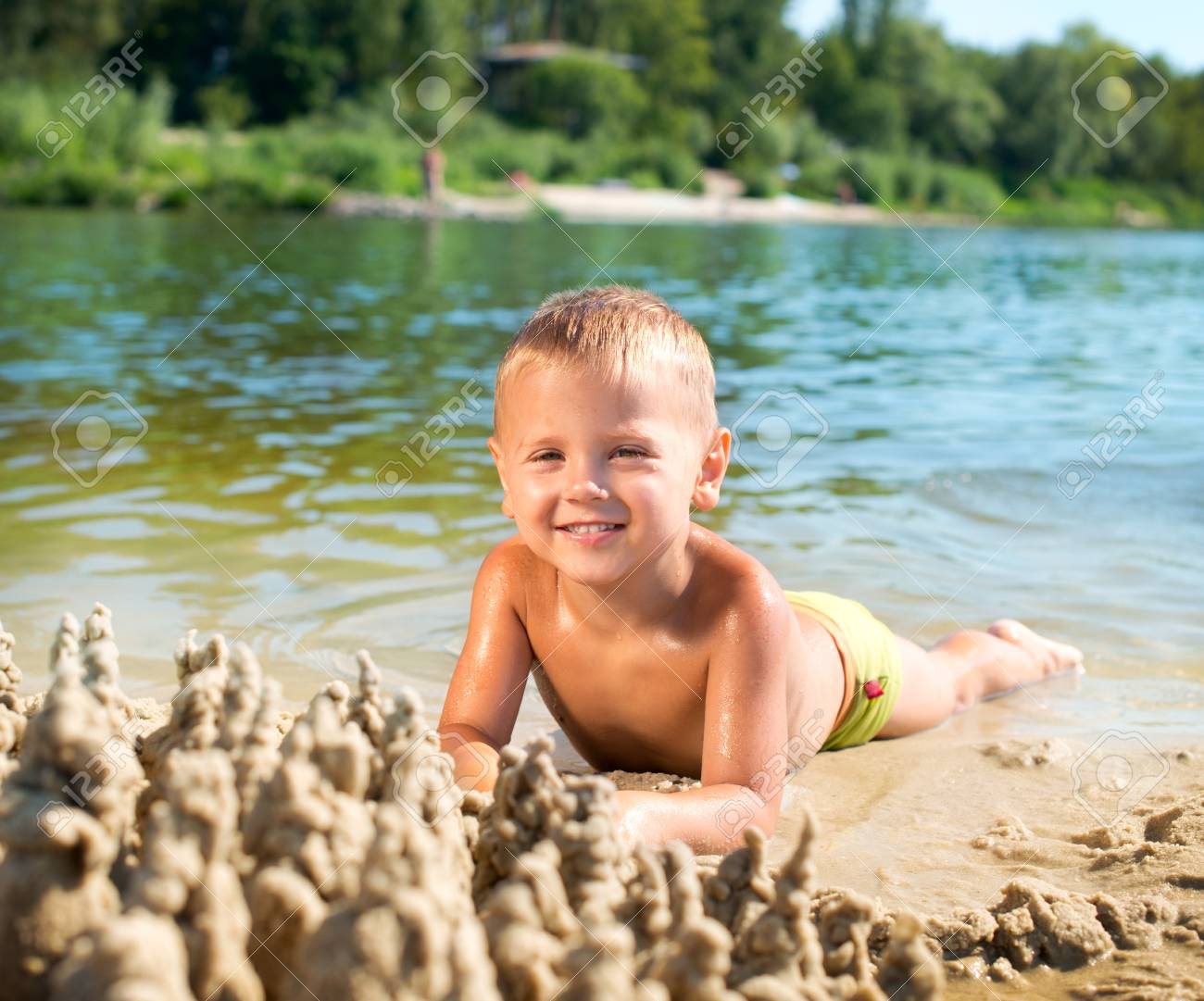 Happy kid playing at the beach in summer  River Stock Photo - 14792092