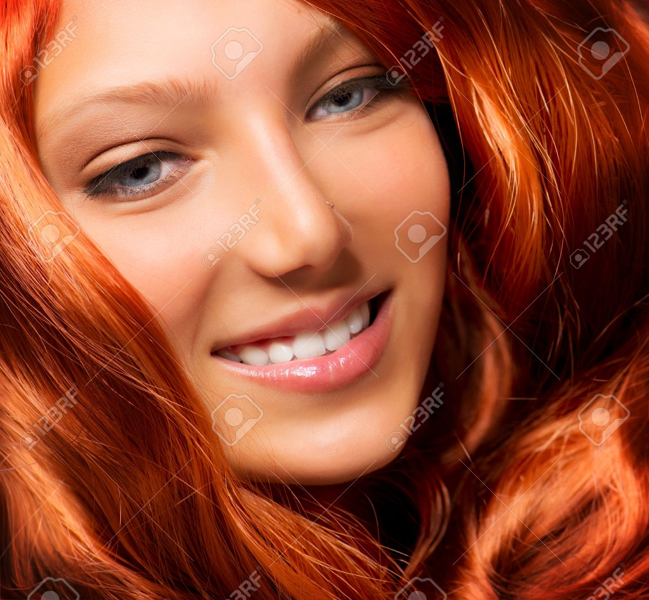 Beautiful Girl With Healthy Long Red Curly Hair Extension Stock