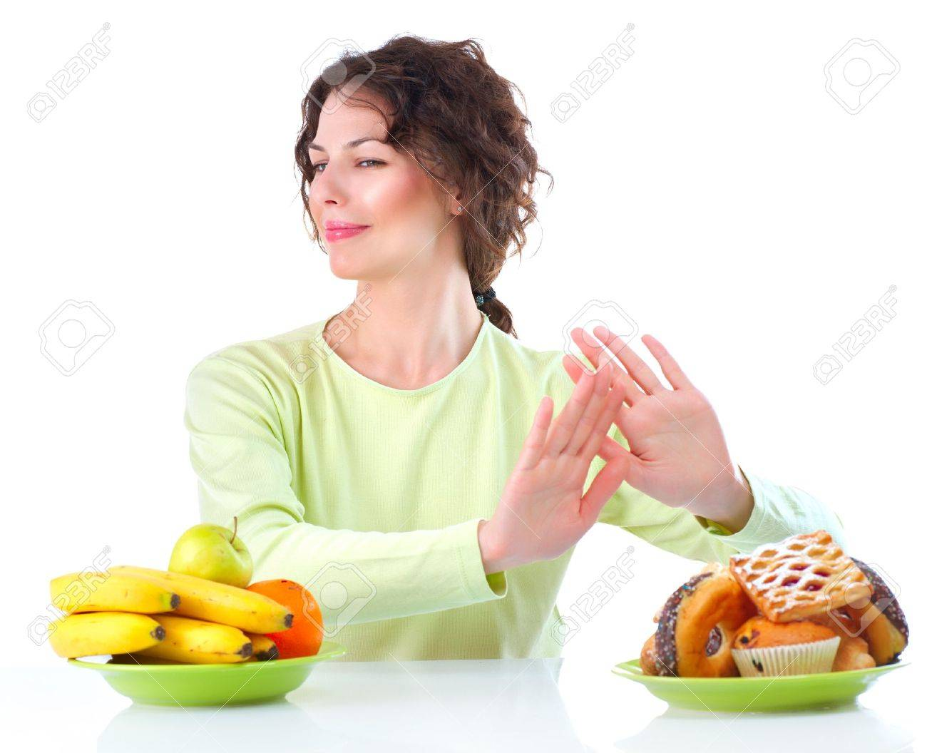 Diet  Beautiful Young Woman choosing between Fruits and Sweets Stock Photo - 15353128