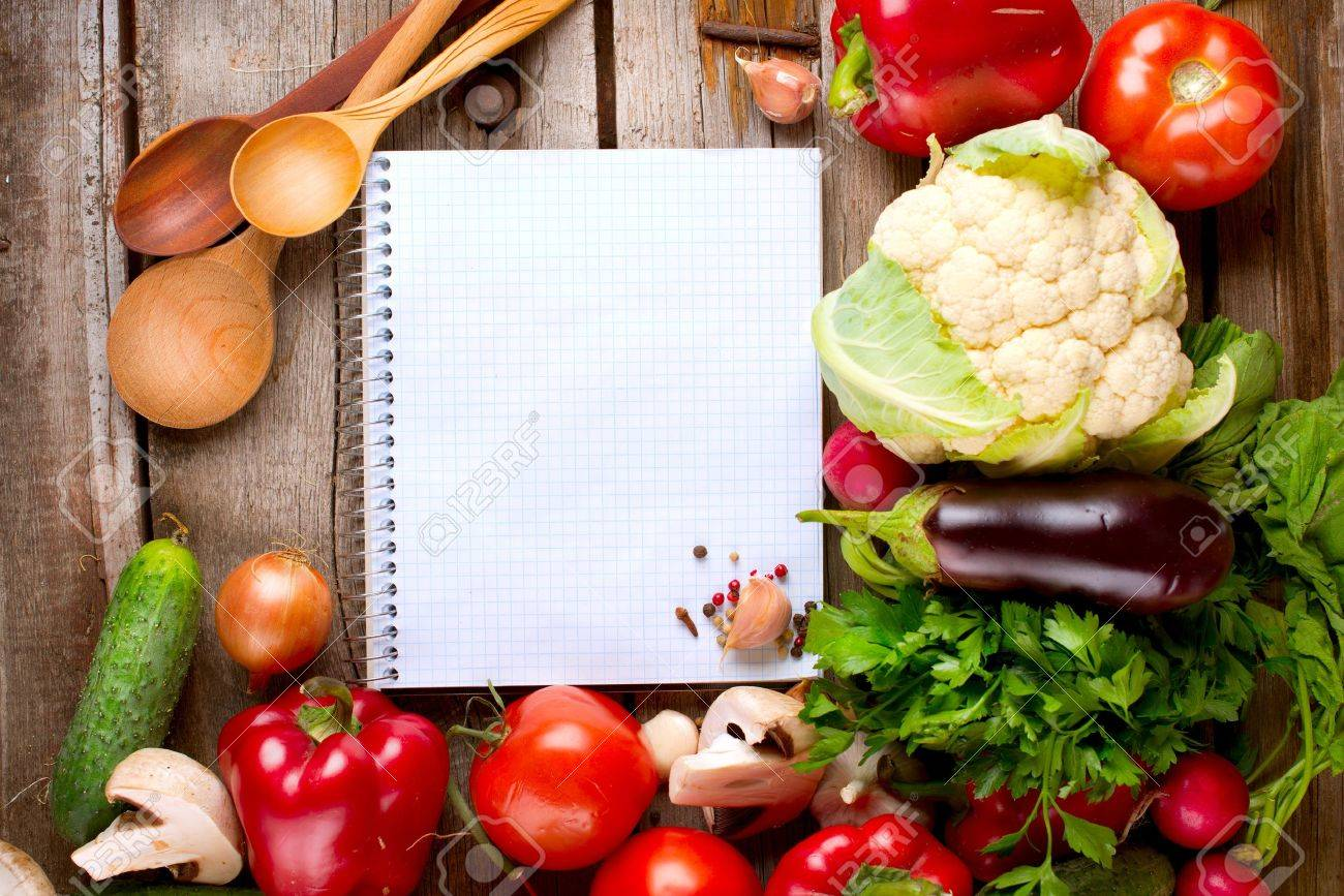 Open Notebook and Fresh Vegetables Background  Diet Stock Photo - 15622406