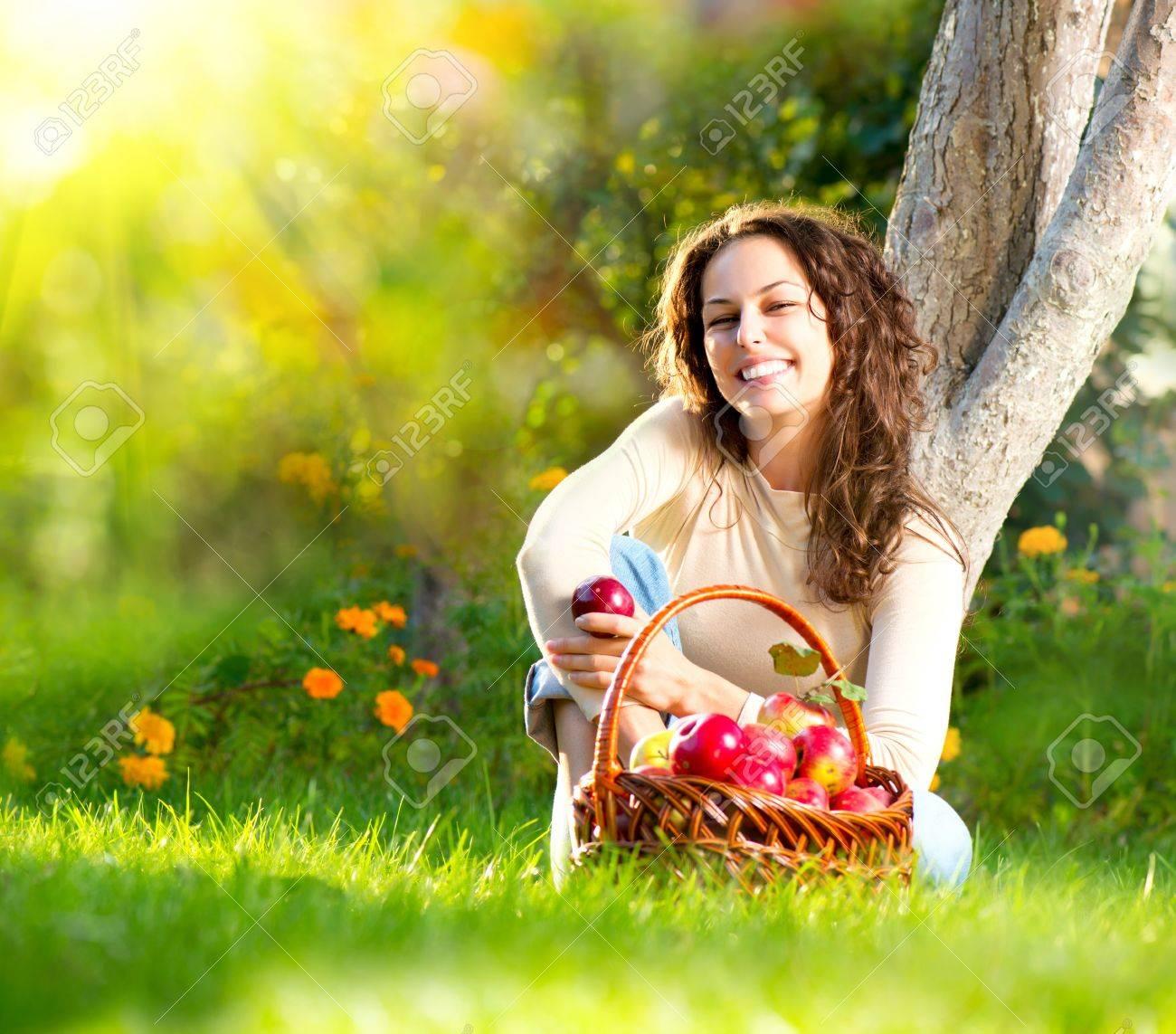Beautiful Girl Eating Organic Apple in the Orchard Stock Photo - 15658041