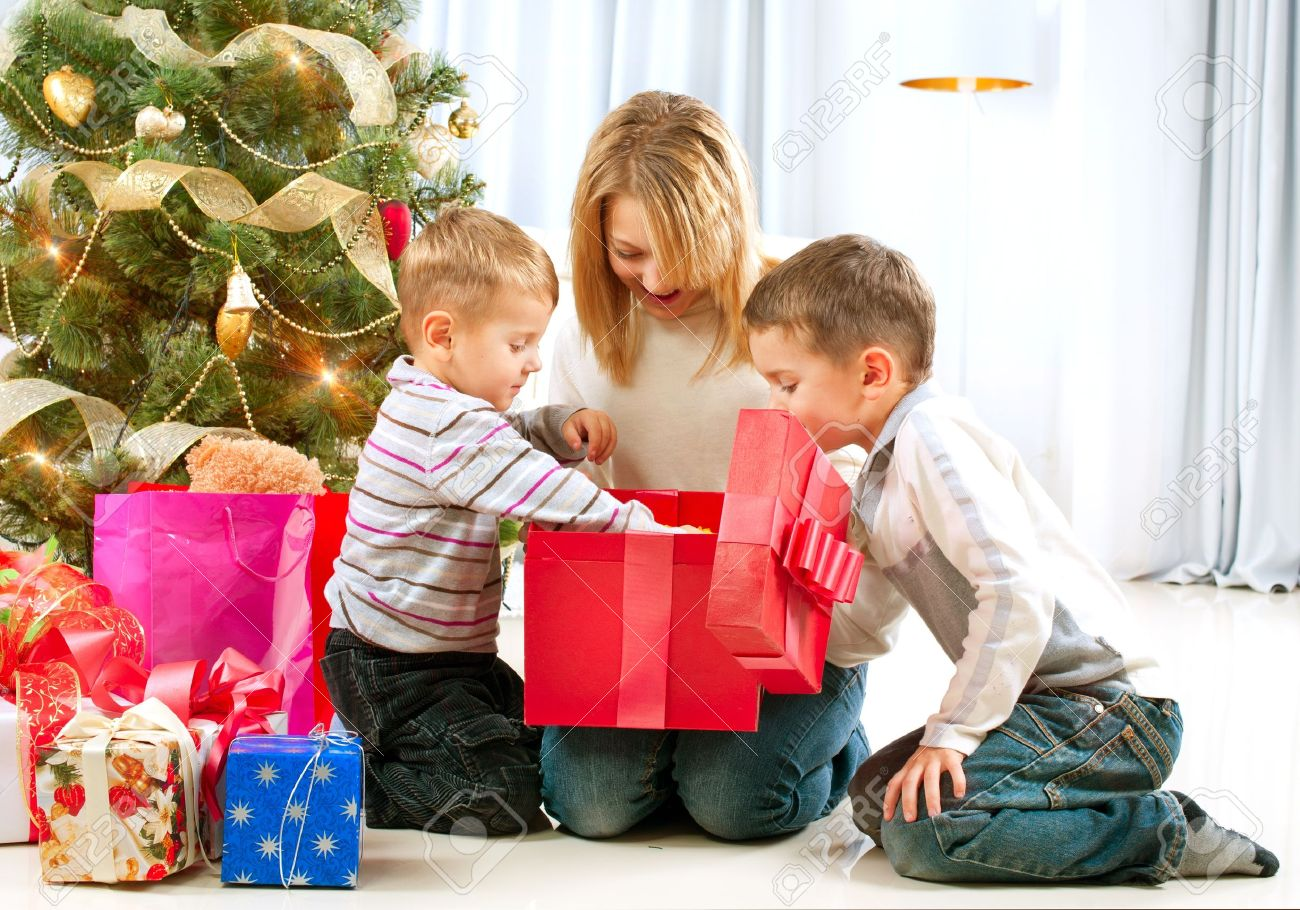 Happy Children with Christmas gifts Stock Photo - 16590140