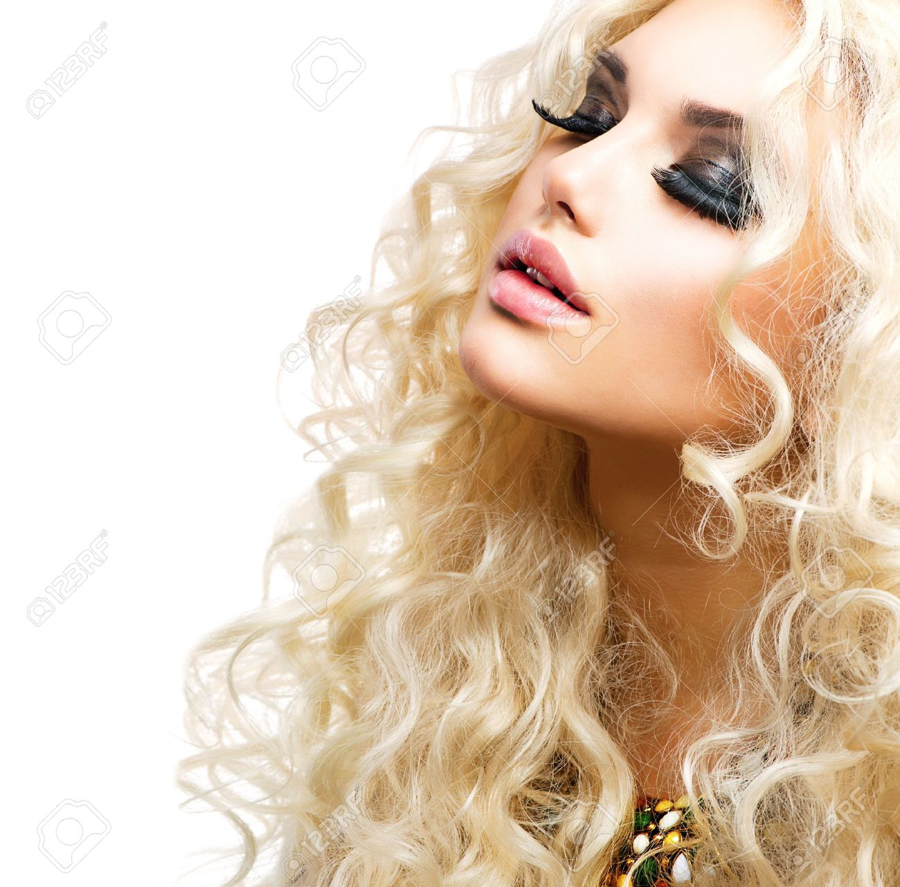 Beautiful Girl with Curly Blond Hair isolated on White Stock Photo - 17384052