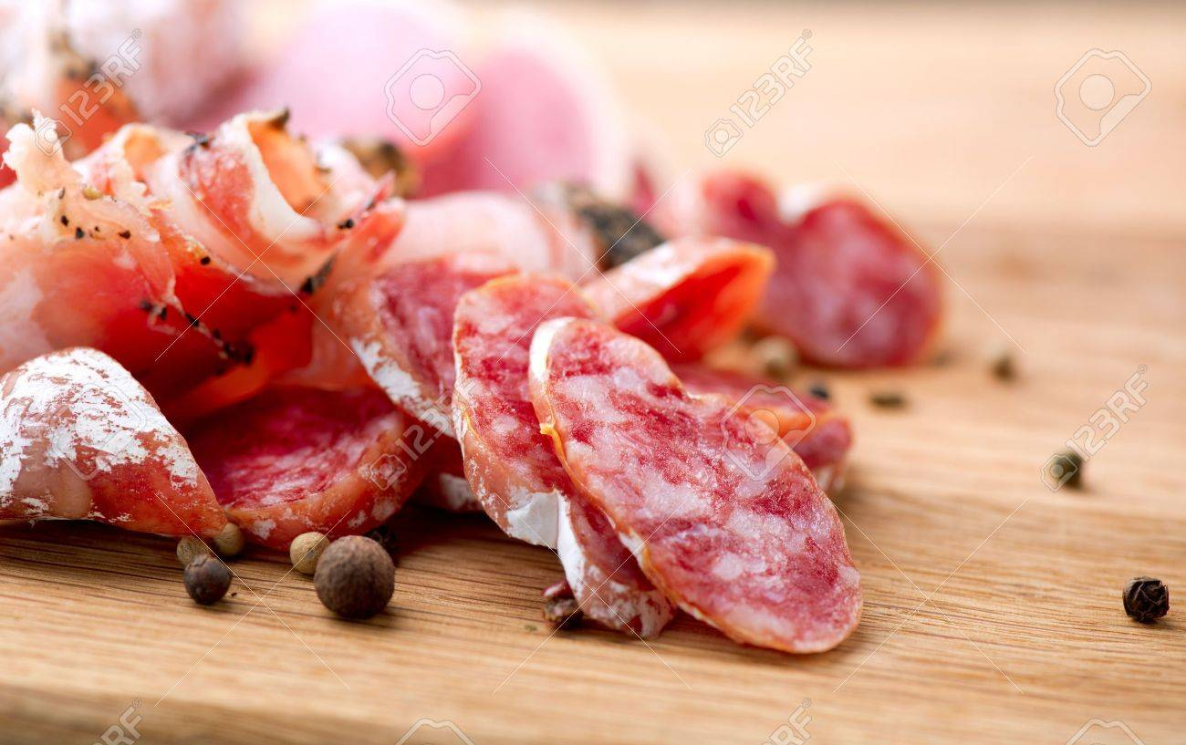 Sausage  Dried Smoked Sausages Sliced on Board Stock Photo - 17603168