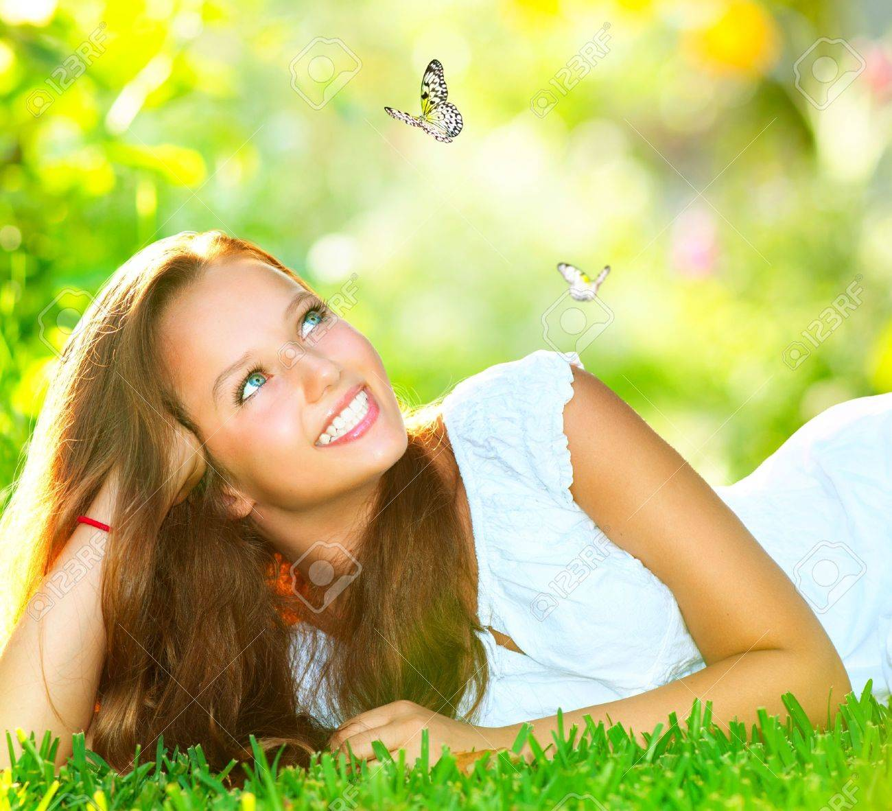 Spring Beauty Beautiful Girl Lying on Green Grass outdoor - 17771906