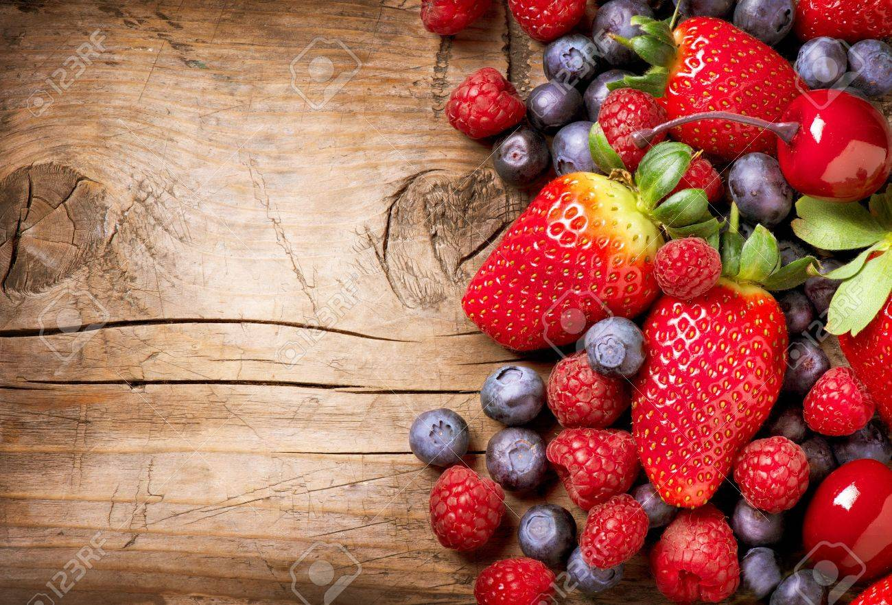 Berries on Wooden Background  Organic Berry over Wood Stock Photo - 18098427