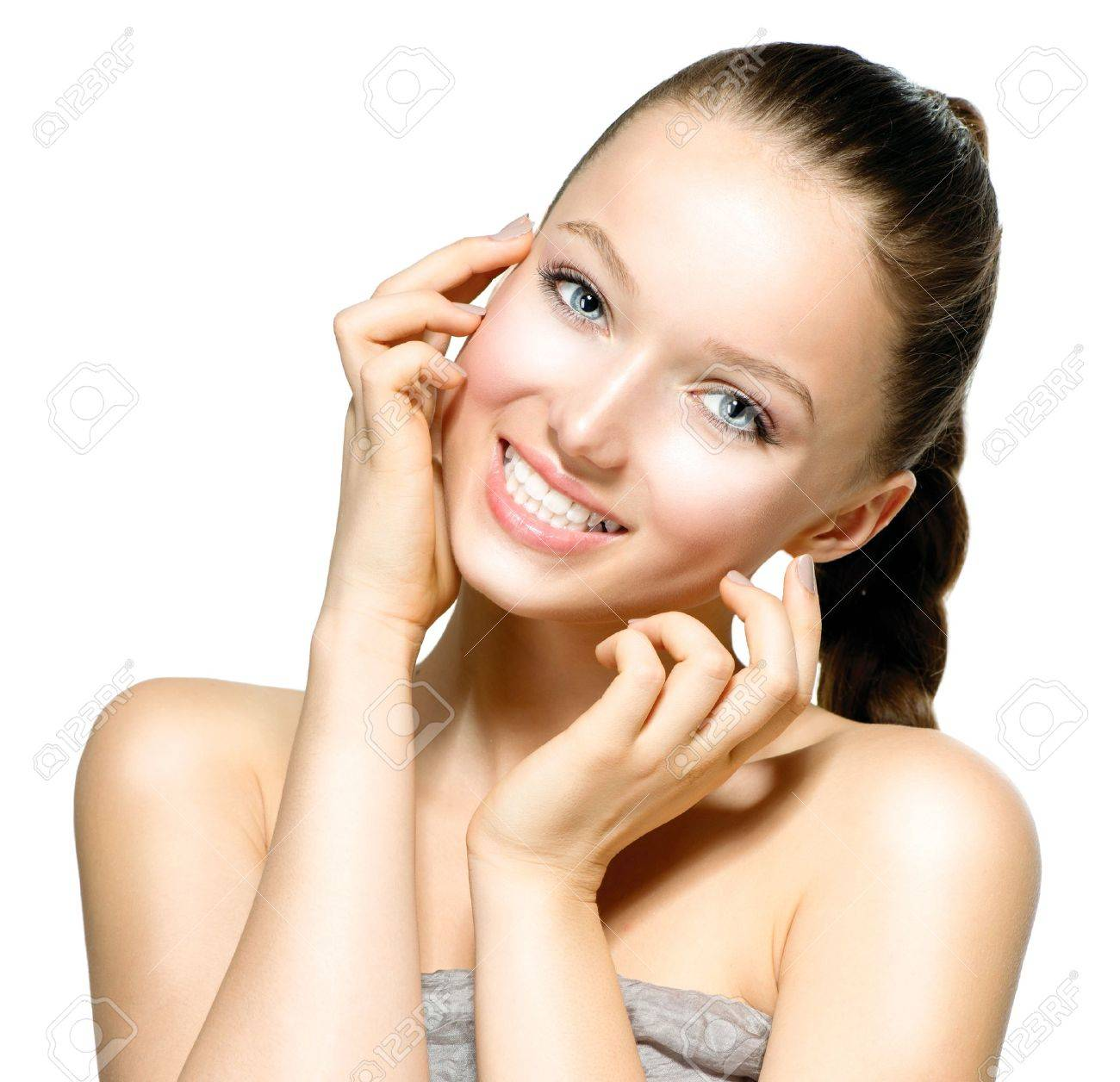 Beautiful Young Woman with Fresh Clean Skin touching her Face Stock Photo - 18294911