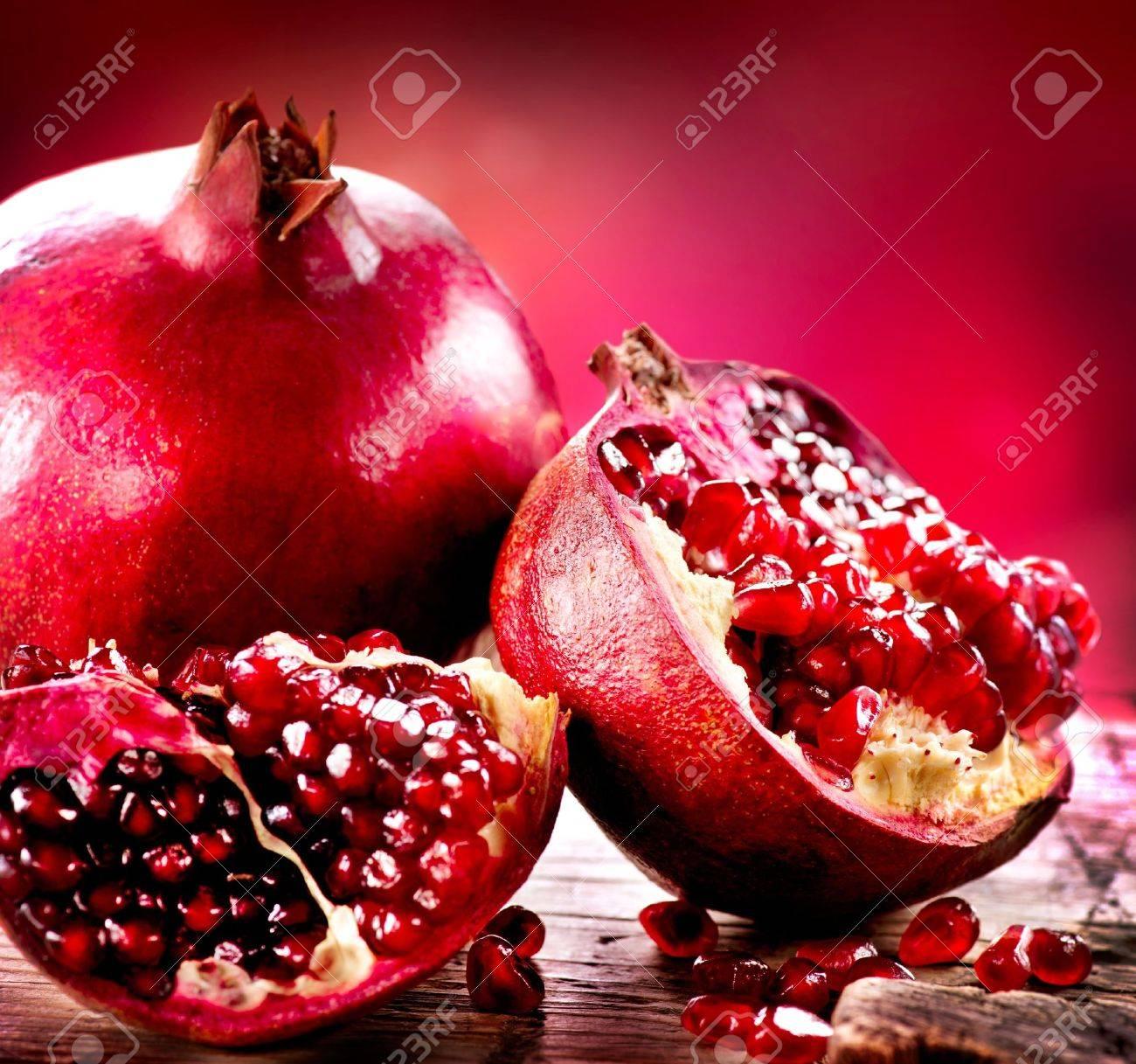 Pomegranates over Red Background  Organic Bio fruits Stock Photo - 18697322
