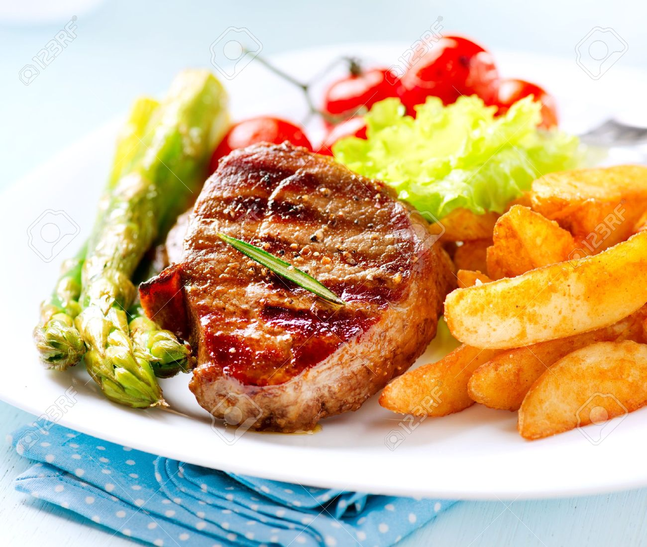 Grilled Beef Steak Meat with Fried Potato, Asparagus, Tomatoes Stock Photo - 18892654