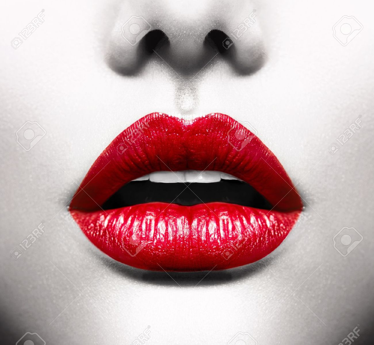 Sexy Lips  Conceptual Image with Vivid Red Open Mouth Stock Photo - 19225069