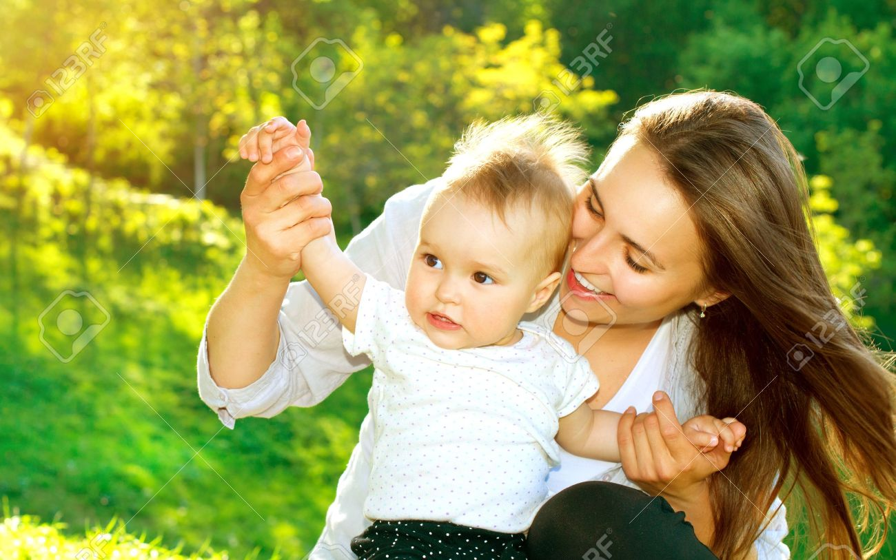 Beautiful mother and baby outdoors nature stock photo 19562138
